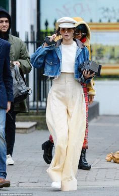 Kendall Jenner exudes Parisian chic in white wide-leg palazzo pants #dailymail