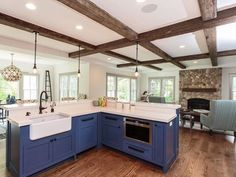 Periwinkle Cabinets + Stone Fireplace