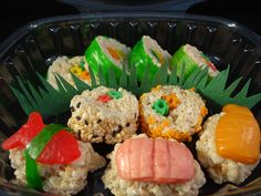 she uses soft candy taffee to shape cooked shrimp and fish shapes for sashimi!