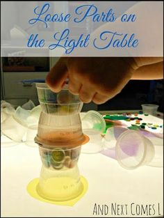 Exploring with loose parts on the light table from And Next Comes