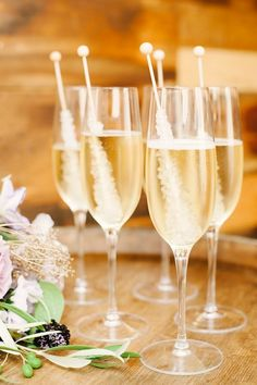 Champagne with rock candy. Fun wedding signature cocktail idea.