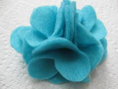 Cute medium sized teal hair flower! My favorite color! $4 on my Etsy Shop - Cortnie's Corner