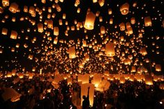 Thousands of Khom Loy lanterns drifted into the sky in Chiang Mai, Thailand, in celebration of the Yee Peng Sansai Floating Lantern Ceremony. The celebration is an homage to the Buddha and coincides with the Loi Kratong festival, which involves floating lotus flowers onto waters nearby.