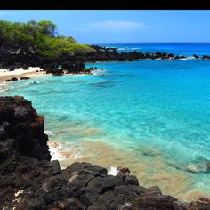 Kona, Hawaii ... white, black, green sand beaches; swimming with turtles; beautiful sunsets; heat; drinks on the beach. <3 here