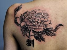 Toronto tattoo shop - Chrysanthemum tattoo with Chinese character on back