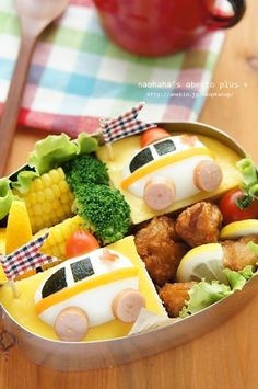 Vehicle Kyaraben Bento Lunch (Boiled Egg in Half, Topped with Sausage and Nori Seaweed, Chicken Karaage, Corn)