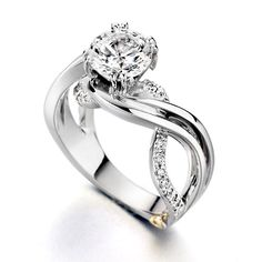 Brides.com: Unique Engagement Ring Settings. 14k white gold and diamond Enchantment ring with round diamond center stone, about $3,500 (without center stone), Mark Schneider See more white gold engagement rings.