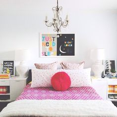 black and white with bold fuschia and chandelier over bed. LOVE those prints, too!