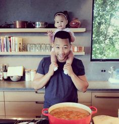 John Legend in the kitchen with Luna. | These Photos Of Hot Celeb Dads With Their Kids Will Make You Pregnant