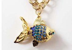 Make your own sea-inspired necklace - Sea Sparkle Rhinestone Fish Necklace from @Plaid Crafts #diyjewelry