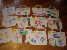 Xmas 2010. Purchased online calico shopping bags and a bunch of fabric paint!  The older kids painted pictures, the younger 2 we just did hand and foot prints :)