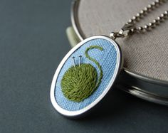 Embroidered Pendant Knitting Necklace Reserved for Jenna. $20.00, via Etsy.