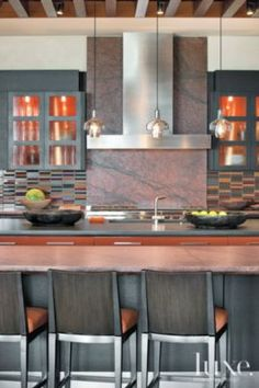Red #Stone #Modern #Kitchen with #Axis #barstools and #granite countertop