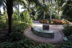 A brightly colored tiled bench awaits visitors at the Florida Botanical Garden in Largo.