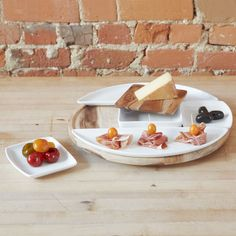 SPUN LAZY SUSAN Designed by Dennis Cheng | Umbra available at Modern Intentions. Shop here for modern serveware and dishes!