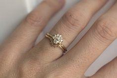 0.25 Carat Oval Diamond Ring With Halo Diamond Crown by MinimalVS