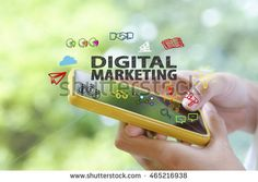 hand holding a smartphone with DIGITAL MARKETING concept , business concept
