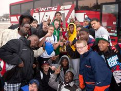 The Omaha Jackals, a North Omaha football team, pose for a team photo after returning from a tournament in Texas with the championship trophy on Jan. 23, 2012. The team was outside Omaha Northwest High School.