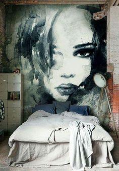 Маленькая спальня в стиле Лофт с аквареным портретом на стене. Фотообои