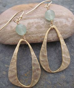 Gold plated free form hoops, faceted aventurine bead. Hammered, matte finish.