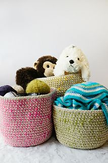 Crocheted in plain parcel string, these baskets use a chunky bright yarn worked under the double crochet to add interest and colour. Useful, simple and beautiful, the versatile baskets will make a great addition to your home.