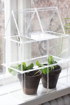 Small green house made from old CD folders and glue, such a clever idea