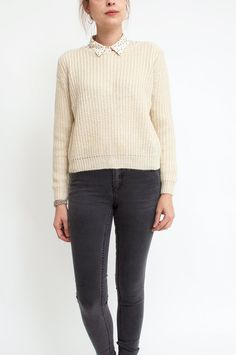 Crafted from a sublimely soft mohair and cotton blend, this sweater with subtle gold lurex wears with the utmost comfort. In a lovely ecru hue, this chunky knit piece features a round neckline and a gold glitter-button fastening on the back. Work yours with downtime denim for a look of laid-back glamour. From Sienna With Love.   	   	Available at Sienna &  Faye.