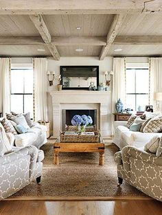 coastal casual living room with weathered wood beams and ceiling, Jane Green via Family Circle