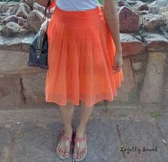 Pretty bright orange pleated dress made from old dupattas. Join our Recycled Clothes initiative.