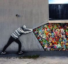 Graffiti, street art, Urban art, art, community art - I really like this piece of art because it has a lot of meaning behind it. It shows a blank wall that is being torn apart and behind it is so much color that is hidden. Murals Street Art, 3d Street Art, Urban Street Art, Amazing Street Art, Street Art Graffiti, Street Artists, Urban Art, Amazing Art, Street Art Utopia