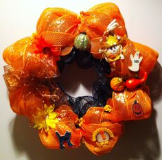 A fall wreath in orange and black mesh with hints of fall, thanksgiving and halloween -- please visit my Facebook page:  Love-My-Wreath by Ria's Creations