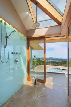 Natural light shower area with green glass shower wall