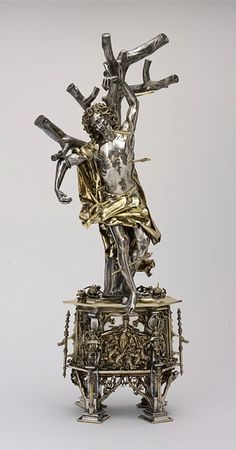 """""""A silver, gilt, glass, pearl, sapphire and ruby reliquary of St Sebastian, probably made in Augsburg, Germany, in 1497; the saint is shown pierced by arrows, his symbolic attributes."""
