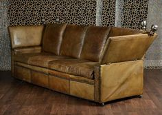 Large Antique French Leather Knole Sofa and Matching Chair on Casters Attributed Maison Jansen All Original with Exceptional Leather Patina and Color Adjustable Side Arms with Deep Seat Four Back and Seat Cushions and Nail Decor Metal Finials in [...]