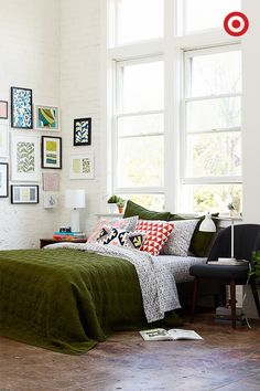 Olive enters the mix as the new neutral—use it on a quilt to anchor your bed, and then experiment with color and pattern through throw pillows and a gallery wall. The mix of olive and pops of color will effortlessly energize your room, turning a blank space into a stylish standout. Two more easy tips: Skip a headboard by putting your bed under a window, and use a mid-century modern chair as a sidetable.