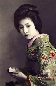 "Geisha from Tokyo.  Hand-colored photo"" about 1900, Japan."