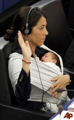 Italian Member of the European Parliament Licia Ronzulli takes part in a vote as she cradles her baby. Power to Working Mamas! It can be done!