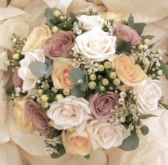 Peaches and Cream with a little Vintage purple. Peach Avalanche, Vandella and Amnesia roses with Hypericum Berries, Waxflowers and Eucalyptus. Flowers and photo by Sharon at www.blushbespokeflowers.co.uk