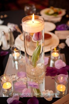 Not sure about center pieces. ...... maybe more petals ?? Flowers in water with tea candles