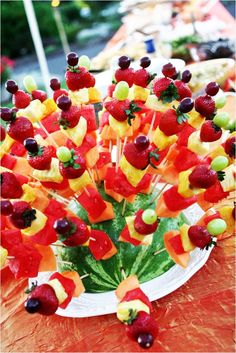 Fruit skewers for a summer event displayed in a watermelon