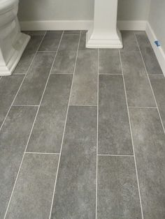 VARIGATED DARK GRAY TILE FLOORS Wide plank tile for bathroom. Great grey color! would love for all bathrooms.