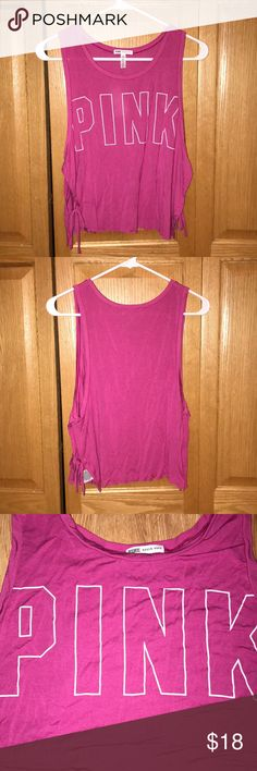 NWOT Victoria's Secret PINK Tank Top NWOT Victoria's Secret PINK Tank Top. Never worn!! Open sides with tie on bottom. Super soft material. PINK Victoria's Secret Tops Tank Tops