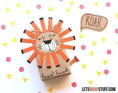 Turn boring brown paper into a cute sleeping lion gift wrap. All you need is brown kraft paper, colored cards, a black Sharpie, and glue! Source: Lets Wrap Stuff