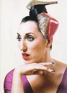 Rossy de Palma in Louboutins.  Who said Louboutinfootwear was only meant to go on your feet?!?!.Almodóvar superstar Rossy de Palma.  Follow me onTwitter:@fj_vargas