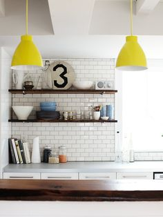 open shelves, subway tile, rustic wood & pop of color