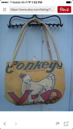 Vintage Conkeys feed sack Carpetbag. www.ginnymae.etsy.com