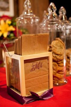 Monogrammed bags filled with cookies is a special wedding favor treat.  See more cookie bar wedding favors and party ideas at www.one-stop-party-ideas.com