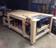 My take on the 'ultimate workbench!' Homes for my table saw and router setup, along with ample workspace.