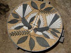 Flying Fantails. Mosaic of 2m in diameter in Kaipara Coast Sculpture Gardens, Auckland, New Zealand . By John Botica. www.powerofpebbles.com