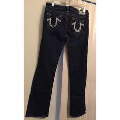 True Religion straight jeans (dark wash) pocket stitching is white with sequence. great condition! True Religion Jeans Straight Leg